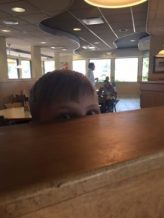 Danny peering over counter