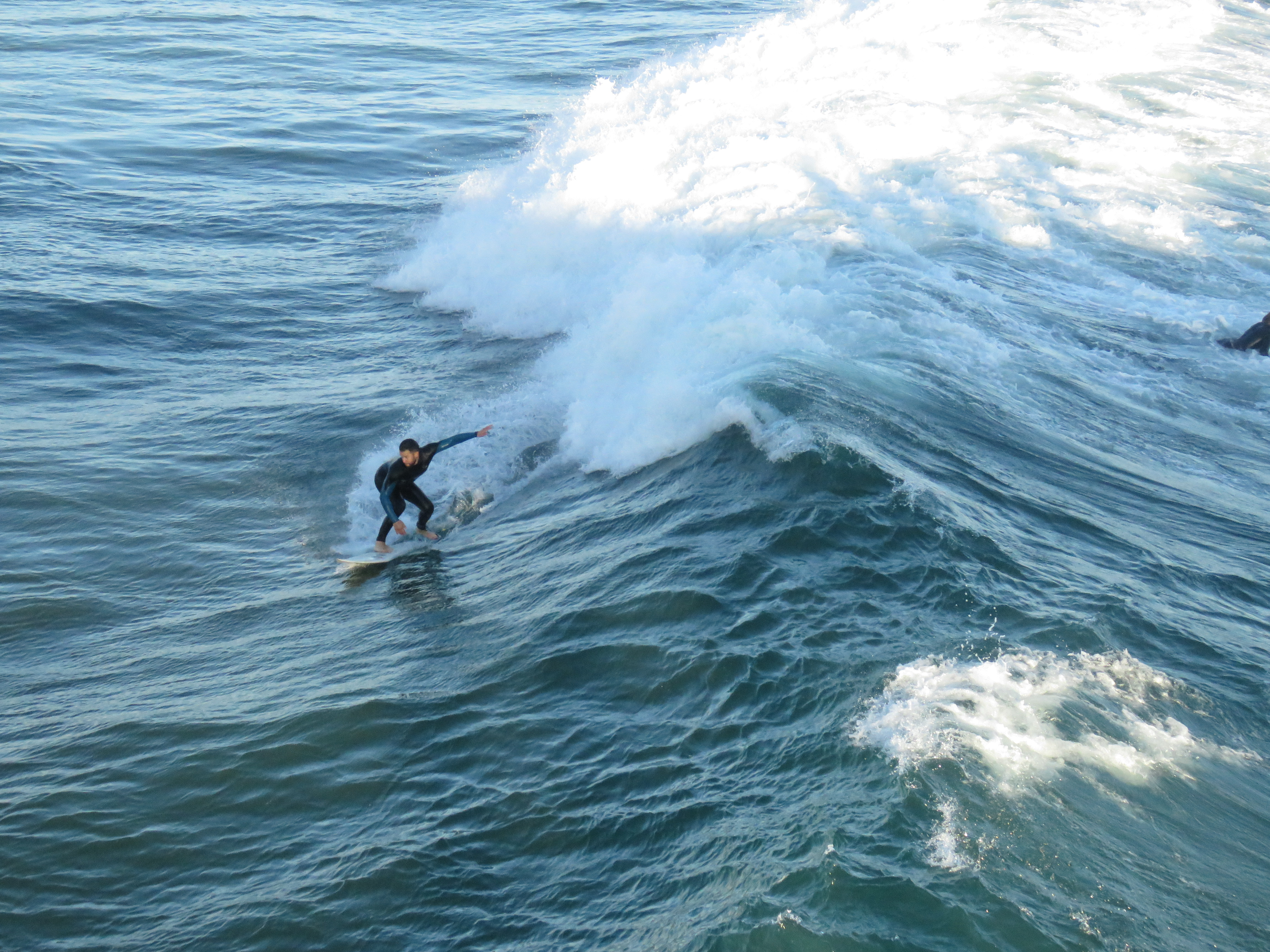 surfer riding upcoming wave